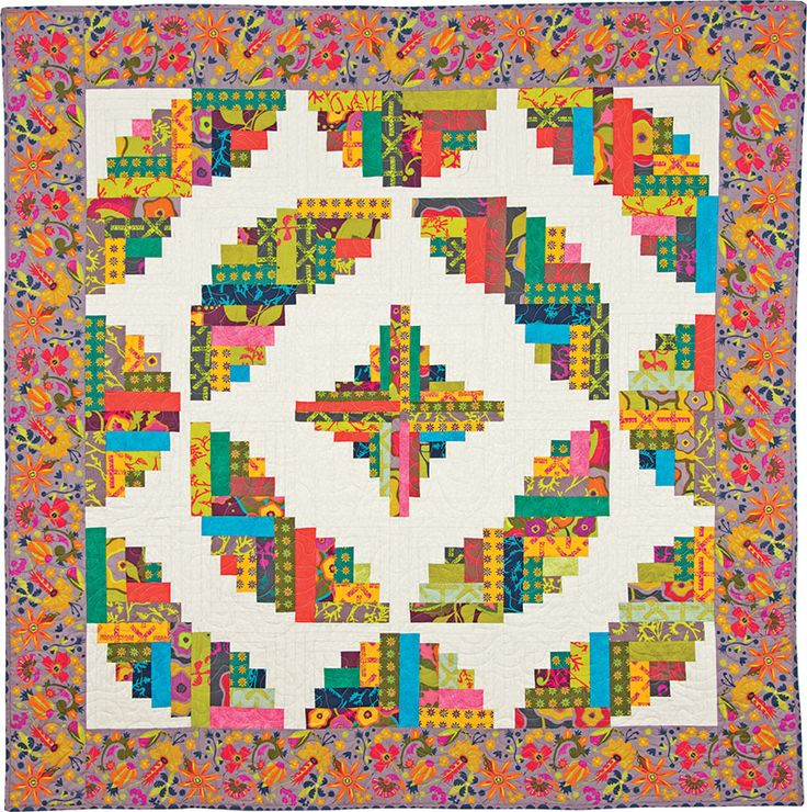 """The Curvy Log Cabin Quilts + Ruler Value Package will ship by 10/20    Learn to create the illusion of curvy quilt designs using cleverly designed log cabin blocks created with 1-1/2"""" and 2-1/2"""" fabric strips. Create fun curves, waves or circles—all with straight-line stitching! Yardage requirements and cutting charts are provided for a range of block sizes.  Includes complete instructions to make eight unique, curvy log cabin projects. Plus clear, concise, step-by-step photos and…"""