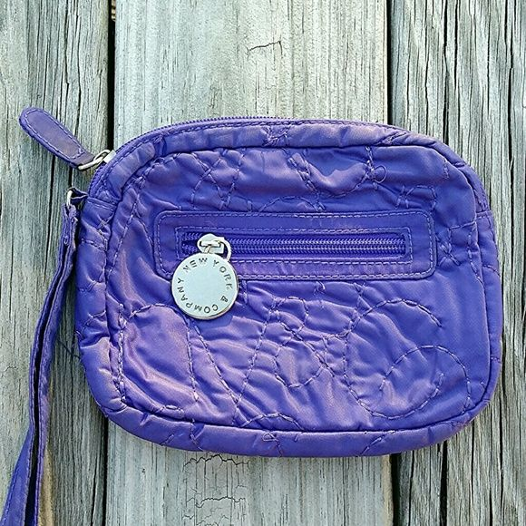 Cute Purple Clutch Really cute! Cloth material. Has main zipper compartment plus small zipper inside and additional outside zipper compartment. There is a stitch pattern on purse. Tiny area near zipper has some pen marks but truly not noticeable. Measures about 7.5 inches across 6.5 inches in height. New York & Company Bags Clutches & Wristlets