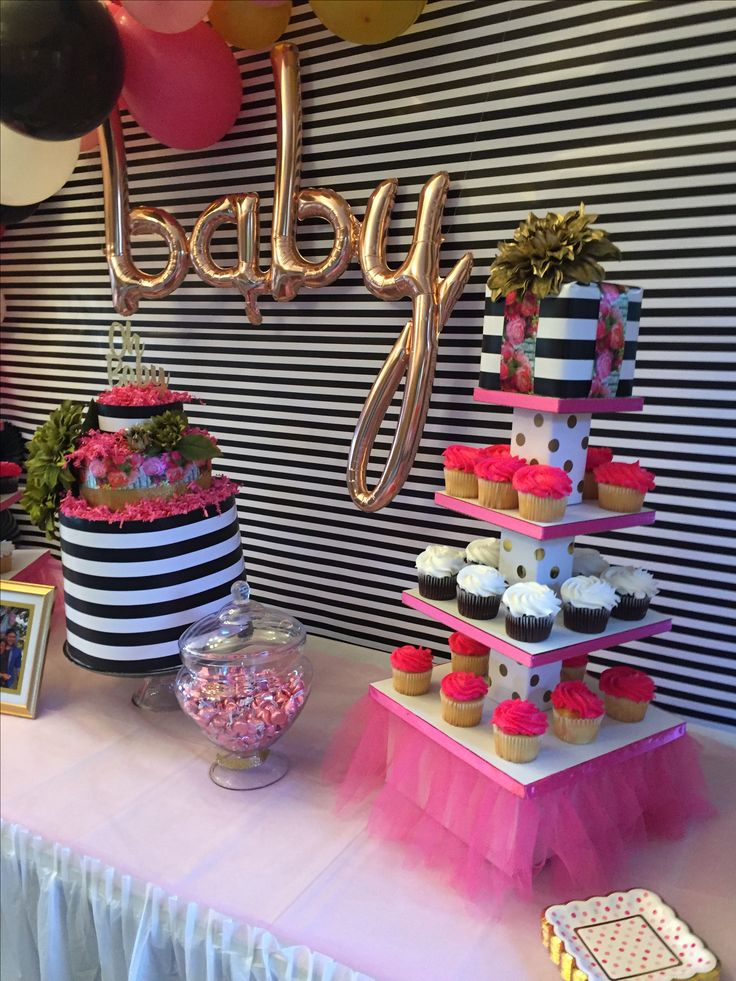 Baby balloon -target  DIY diaper cake & cupcake stands  PVC pipe backdrop and wrapping at hobby lobby