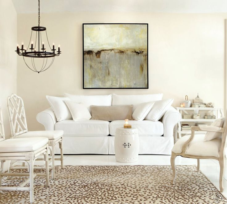 White living room with leopard rug and neutral accents