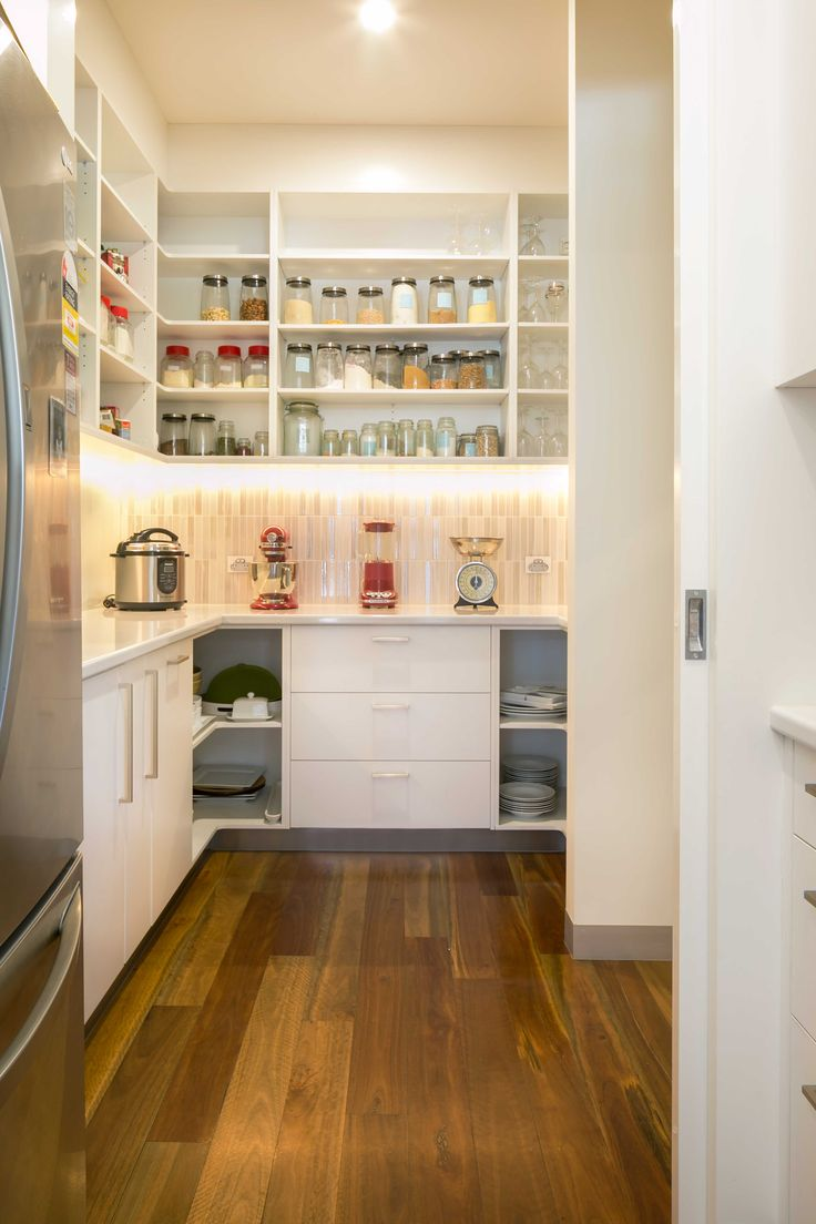 Butler's Pantry - Shelves and Cupboards in Laminex White Natural finish. Benchtops in Polytec Chambord gloss finish.
