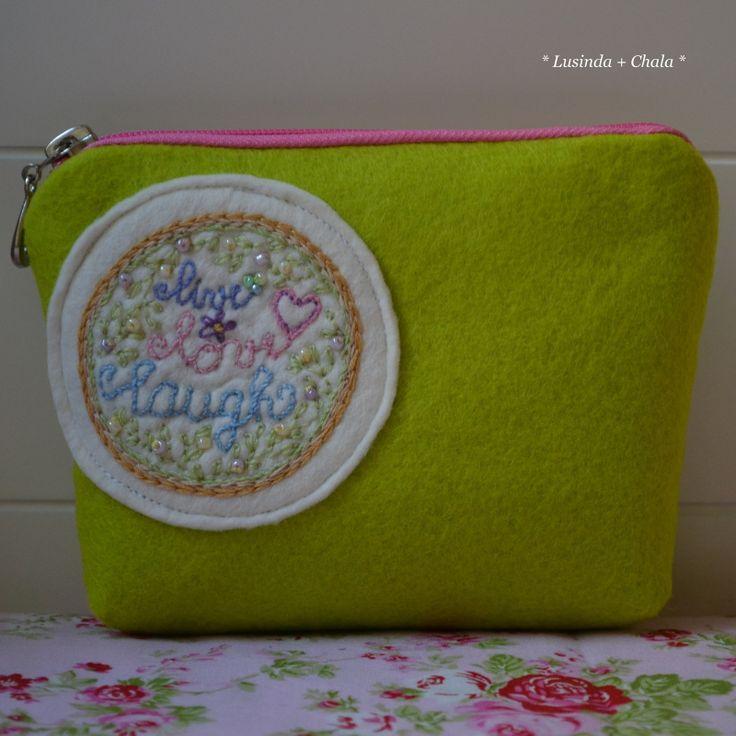 my embroidery... my friend Lusinda´s sewing... a felt purse
