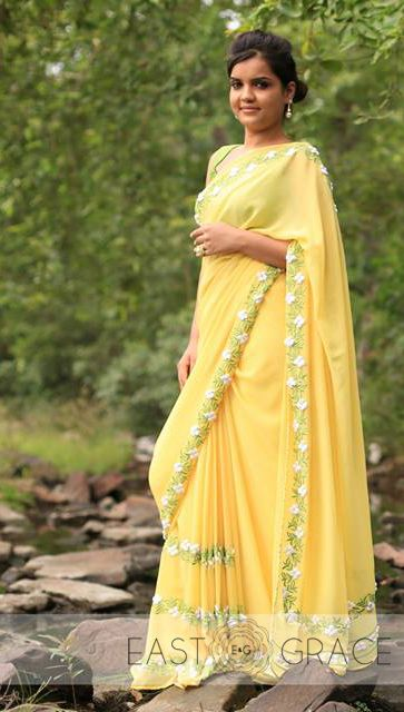 Presenting the White Buttercup. We love how the model styles it simply with pearl drop earrings, the 60s flower ring and beautiful messy updo. Her smile makes it all the more beautiful. Please visit www.eastandgrace.com and subscribe to our newsletter to find out when White Buttercup will be available for purchase and other awesome things! #saree #lehenga #indowestern #eastandgrace #love #indianwedding #onlineshopping #indianfashion #pastel #satin #ribbon #yellow #nature