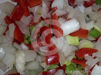 Onion and pepper together in a bowl, photographed indoors at daylight.