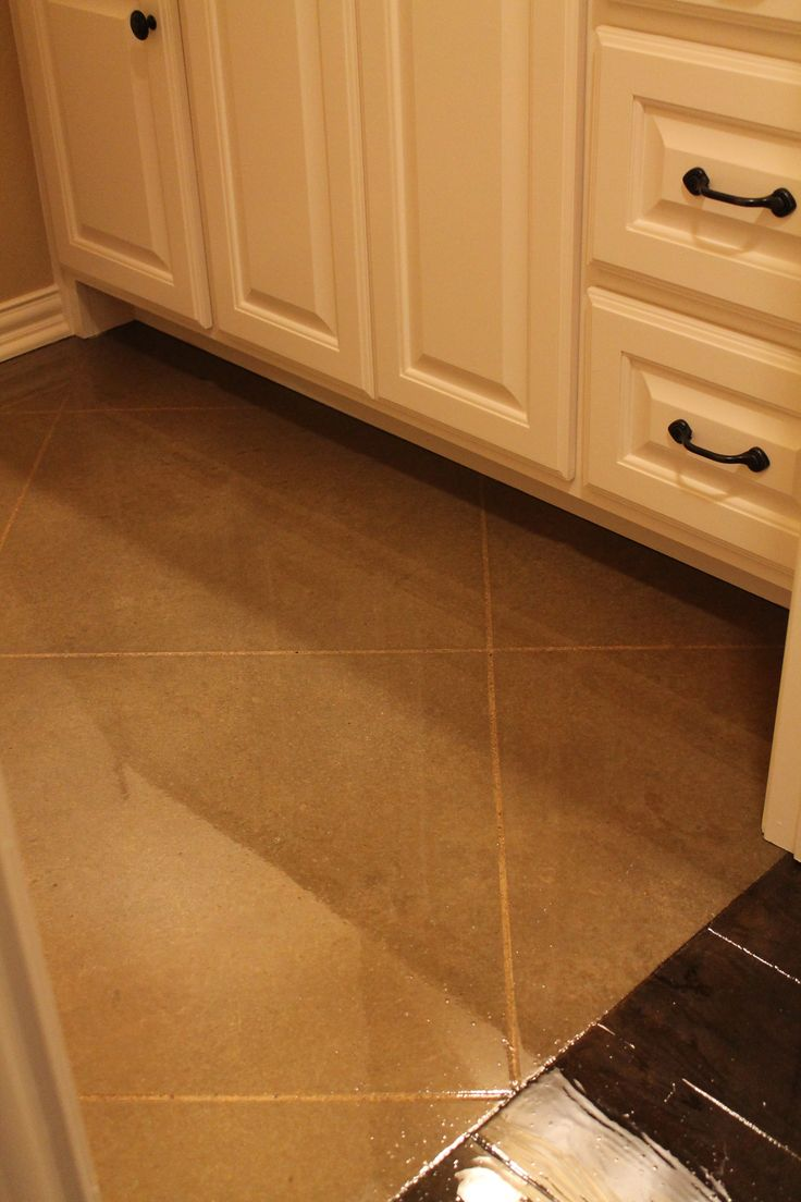 Concrete floors made to look like tile. To see more photos visit www.mckinneyhomesllc.com