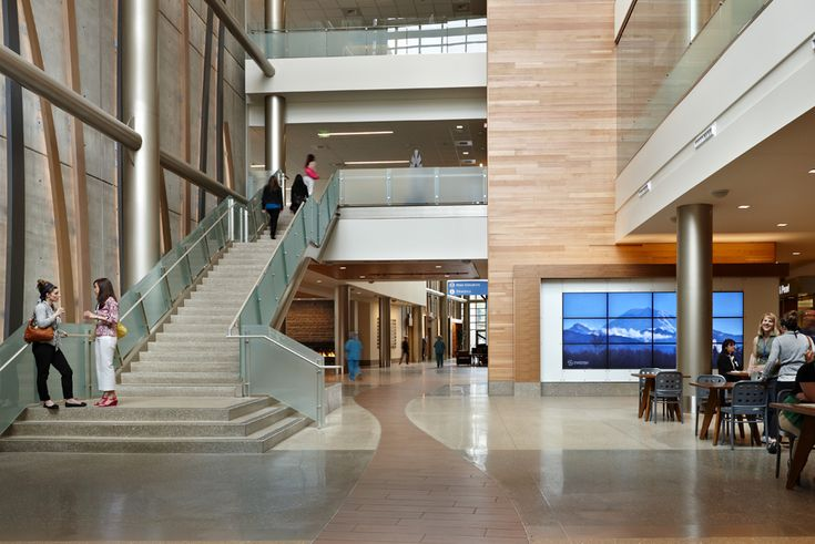 Swedish Medical Center - Reclaimed Teak and Fir Paneling by TerraMai