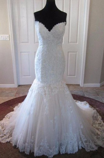 """I purchased this dress for my ex but the wedding didn't go through. The dress has never been worn and has been owned for less than 6 months. The tags are still on it and everything in its original packaging. It's never been altered. White, size 4. 32-24-32. My ex is 5'5"""" (if that helps with the height measurement)."""