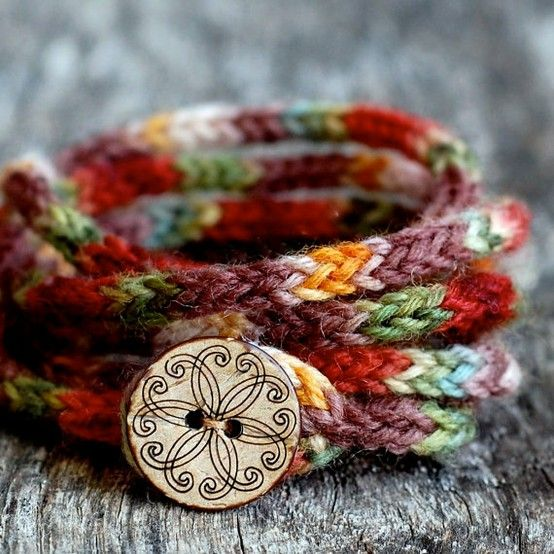 ADORABLE i-cord bracelet with button closure. Could really be made in any yarn.                                                                                                                                                                                 More
