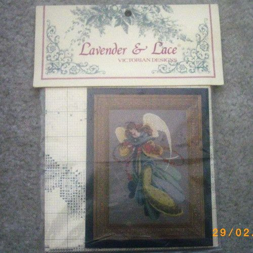 Angelica cross stitch chart with linen fabric
