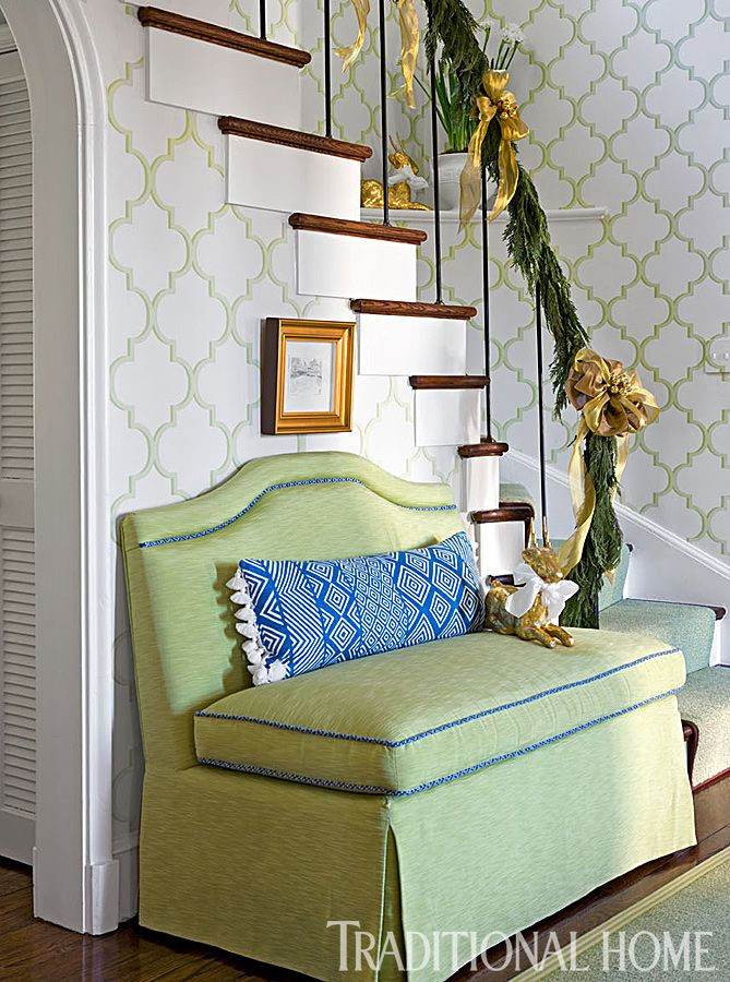 Piped in blue, a lettuce-green settee sits against the Manuel Canovas trellis wallpaper in the foyer. - Photo: Gordon Beall / Design: Kelley Proxmire