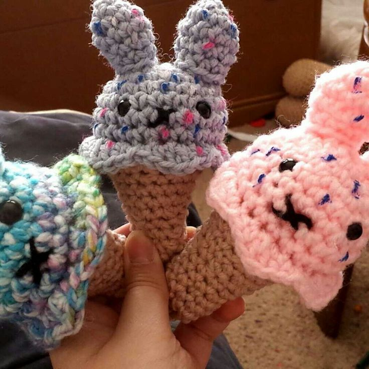 I'm holding three colorful super soft crochet amigurumi ice cream bunny cone. This is so fun to make and so cuddly to play with.  These are great for play food and they are also great for having a fun pocket sized toy to take around any day!