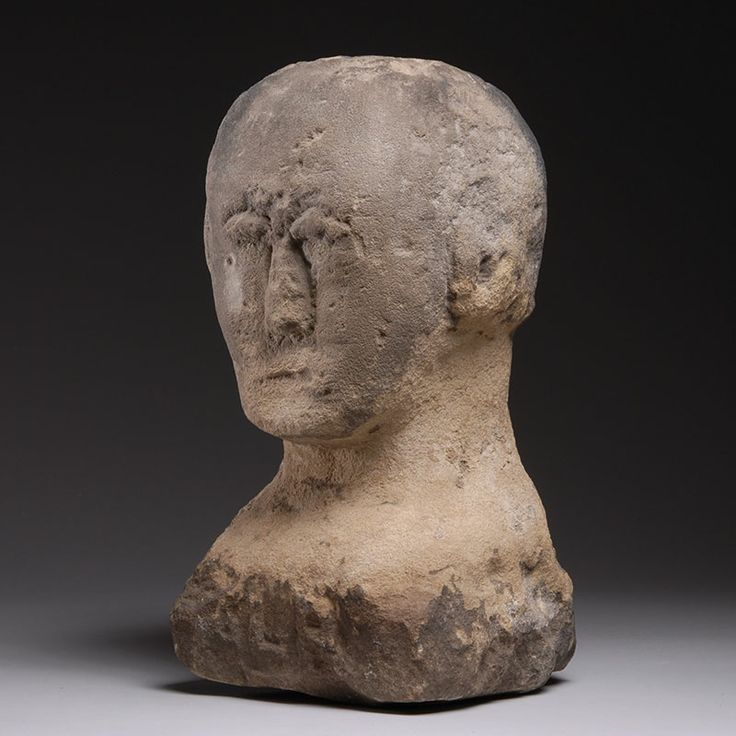 Late iron age celtic stone carving of a human head