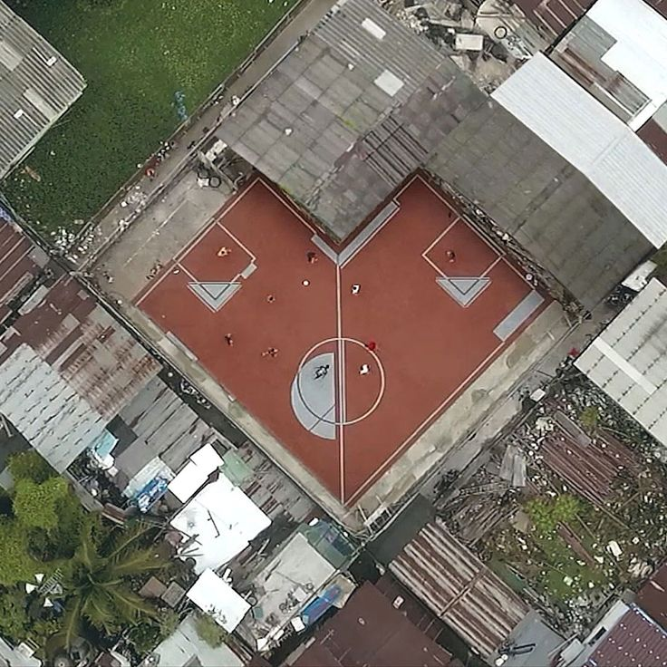 Unused patches of land in a densely populated area of Bangkok have been transformed into a series of irregularly-shaped football pitches for local residents