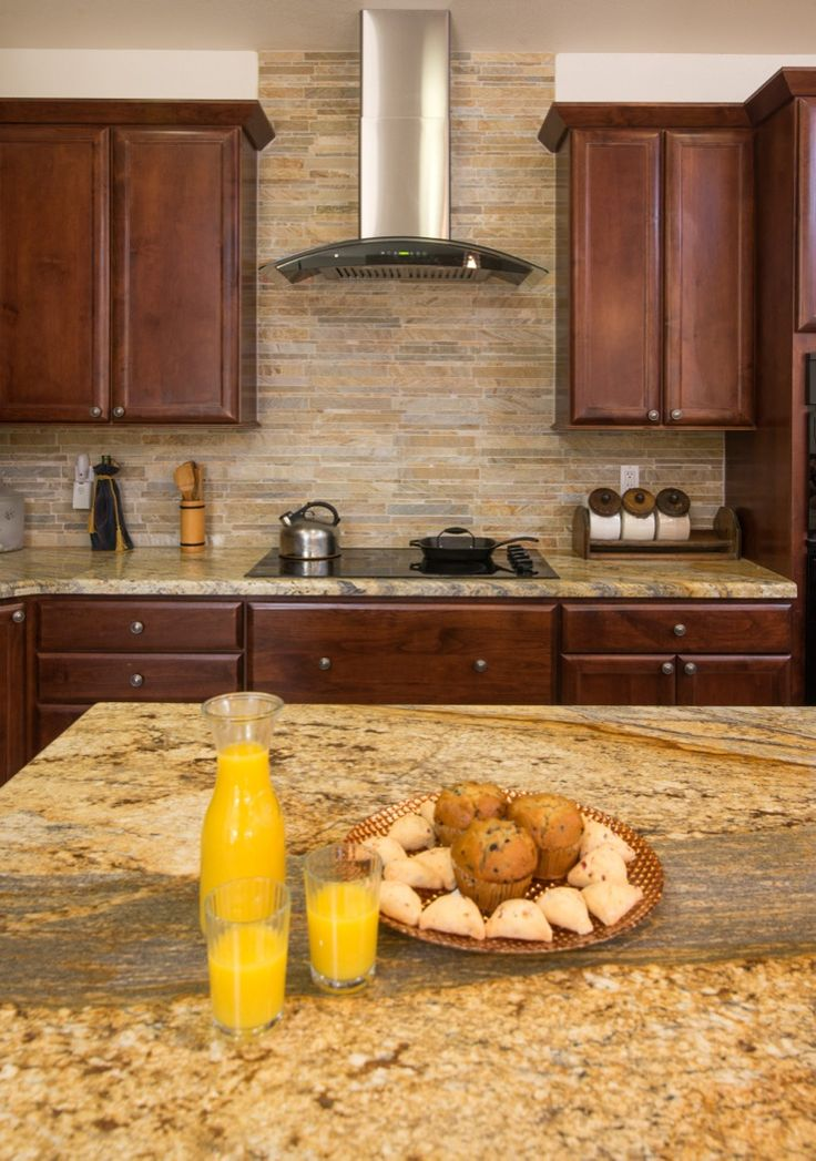 Kitchen Remodel in San Diego. The Yellow River Granite countertop adds the sparkle with a backsplash of tile from Arizona Tile.  remodelworks.com