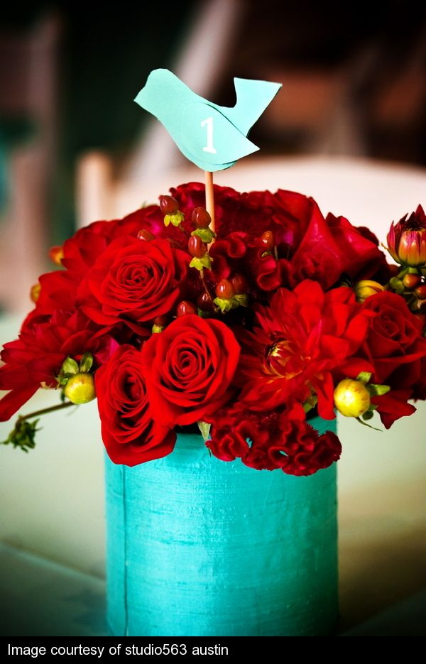 Centerpiece idea using the glass jar...fill with turquoise rocks and red flowers...love the little birdie too, I could make that!