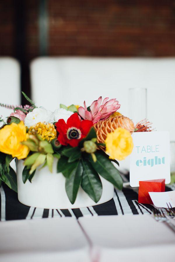 tropical inspired centerpiece, photo by Alison Vagnini http://ruffledblog.com/urban-brunch-wedding-ideas #weddingideas #centerpieces