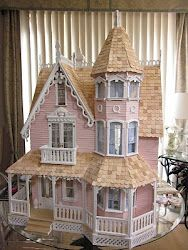 I started this blog to share ideas and inspire those who want to build their dream dollhouse.  I had always wanted an actual miniature dollhouse with all of the trimmings as a little girl.  I decided to build the perfect, victorian dollhouse which of course had to be pink.  Wouldn't it be great to shrink down to fit inside?