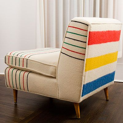Vintage blankets on vintage chairs - The furniture is either antique or made in the U.S. with sustainably-milled wood, then covered with vintage blankets.