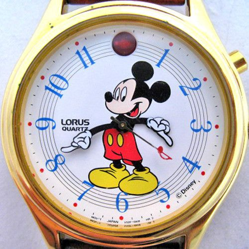 LORUS MICKEY MOUSE GOLD MUSIC MUSICAL Tunes Sound Womens Mens WATCH Leather Band $219 .. we sell more LORUS VINTAGE MICKEY MOUSE WATCHES at http://www.TropicalFeel.com
