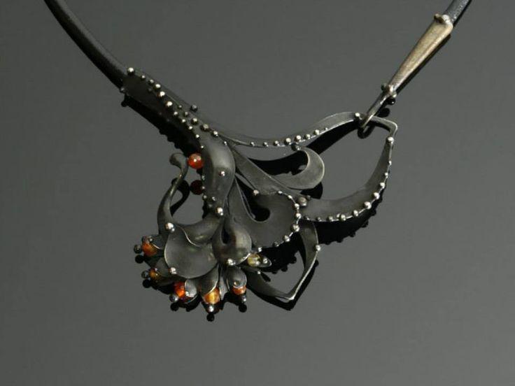 Металлические ожерелья Katia Olivova