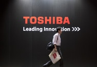 Toshiba Corp. (6502), Japan's biggest reactor maker, plans to sign a 160 billion yen ($1.9 billion) syndicated loan this month to refinance debt and help pay for an acquisition, three people familiar with the matter said.