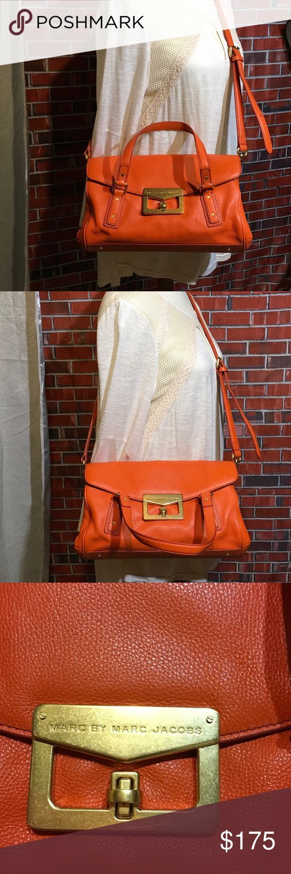 NWT Marc by Marc Jacobs satchel cross body Beautiful orange Italian leather Marc by Marc Jacobs bag. Two handles long adjustable body strap two  pockets inside two zippered pockets inside. Bag has a slight wear from storage (pictured).Bundle for no obligation private discount or send me your offer. Ten percent discount on 2+ items. Any questions don't has to take to ask Marc By Marc Jacobs Bags Satchels