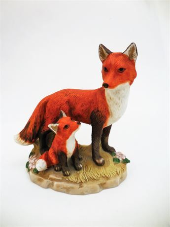 This fox and cub are made of porcelain and from Enesco, Home Interior, 1980's. Measures 4-1/2 inches high, 4-5/8 inches long and 2-7/8 inches wide. Good vintage condition. No chips or cracks. Cute rustic or cabin decor. Would make a sweet cake topper. See more vintage collectibles here! https://www..com/shop/AJewelOfACraft?section_id=16555407&ref=shopsection_leftnav_8 How about vintage Christmas? https://www..com/shop/AJ...