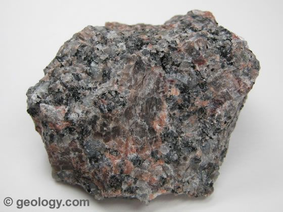 Granite is a coarse-grained, light colored, intrusive igneous rock that contains mainly quartz and feldspar minerals. The specimen above is about two inches (five centimeters) across.