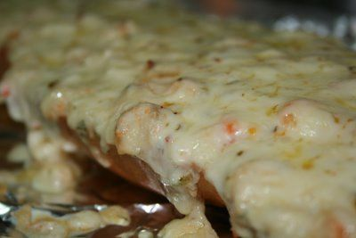Seafood Appetizer Bread - French bread, topped with a creamy white sauce with Parmesan and Swiss cheeses and tossed with shrimp and crab, baked and then finished with a sprinkle of pepper jack cheese.