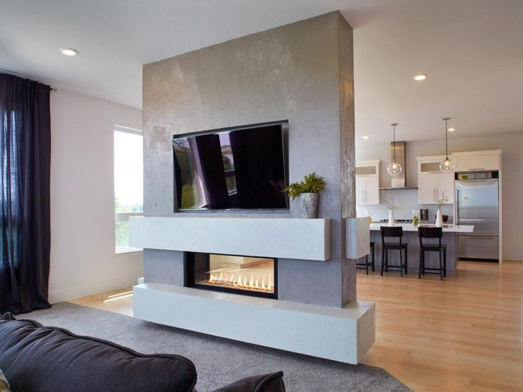 "This fireplace surround was hand-faced by artisans at Granicrete. ""The client wanted to see the trowel marks for a hand-crafted look,"" says Granicrete's Jean Eaton."