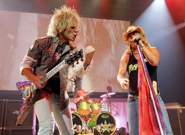 Rikki Rockett (L-R) Poison guitarist C.C. DeVille, drummer Rikki Rockett and singer Bret Michaels, perform during a sold-out show at the Pearl concert theater at the Palms Casino Resort August 17, 2007 in Las Vegas, Nevada. The rock group is touring in support of the new album of cover songs, 'Poison'd!'