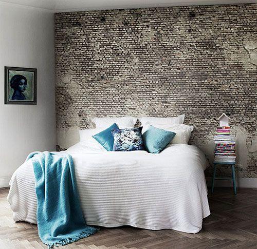 Bakstenen muur in de slaapkamer