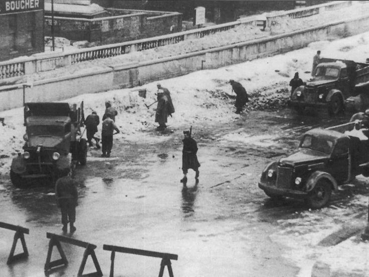 German POWs from the Hamlin Beach camp shovel snow from Rochester bridge