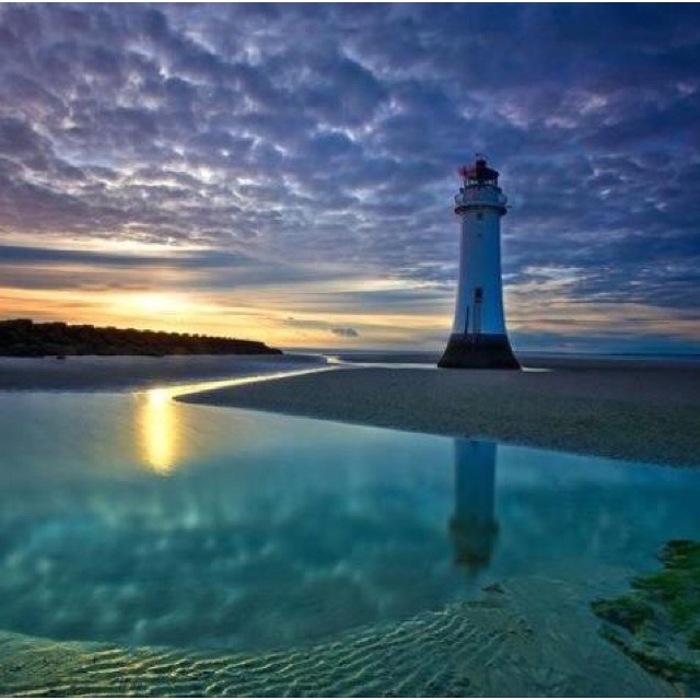 New Brighton Lighthouse, town of Wallasey, Metropolitan Borough of Wirral, Metropolitan County of Merseyside, UK, was originally known as Perch Rock Lighthouse with construction beginning in 1827..