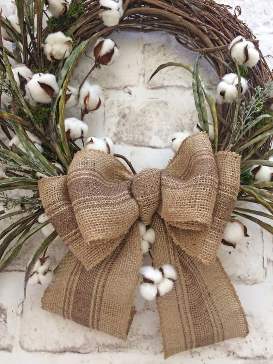 simple cotton wreath with a large burlap bow
