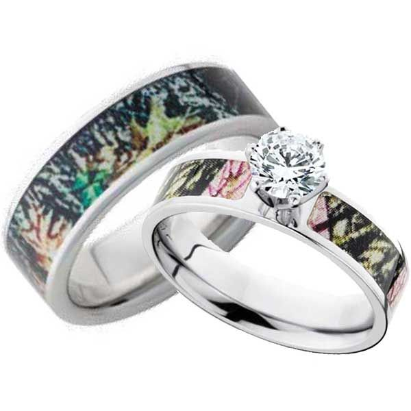 Get a matching set of vitalium wedding bands with Mossy Oak New Break Up and Pink Break up camouflage pattern inlays. Her's is 6 mm wide featuring a .5 carat diamond colored round cubic zirconia stone and his is 8 mm wide.