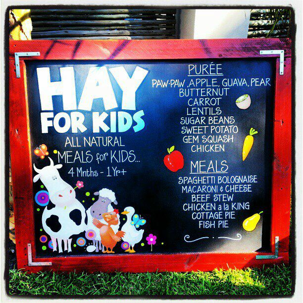 Hay For Kids black board with some of our fresh products.