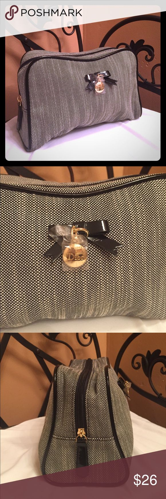 NWOT Dior Parfums Cosmetic Bag Never Used. Dior Parfum Bag. Can be use for comestic and makeup carrier : ) Black Patent Leather Bow, Gold Dior Charm, Black Patent Leather Piping around Cosmetic case Dior Bags Cosmetic Bags & Cases
