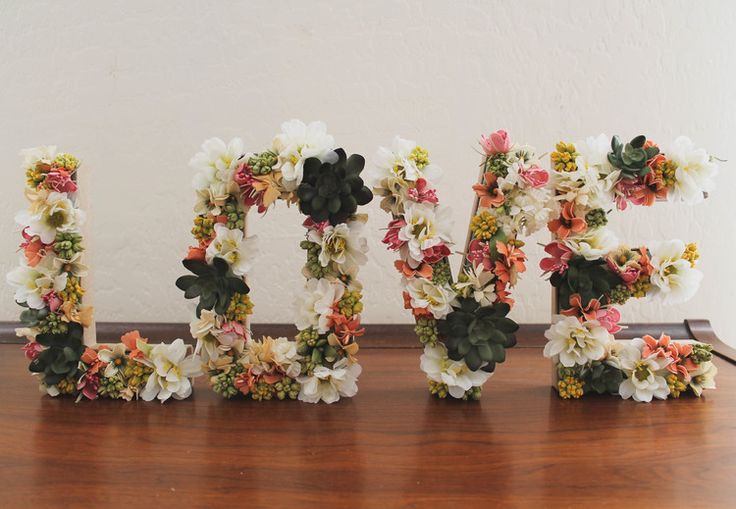 floral covered cardboard letters