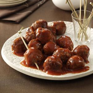 Tangy and Sweet Meatballs Recipe -When we entertain friends for Sunday dinner, I frequently serve these tangy meatballs. Everyone loves the distinctive sauce, but they're often surprised to learn it is made with gingernsaps. -Melody Mellinger, Myerstown, Pennsylvania