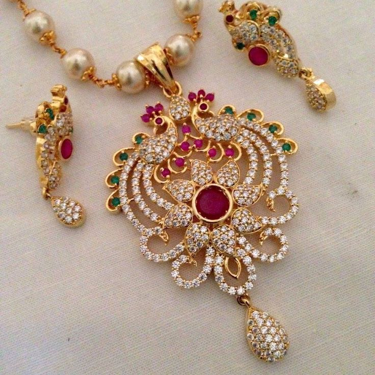 CZ and ruby & emerald pendant with pearl drops and earrings Code : PS 380 Price: Rps. 1195/- Whatsap to 09581193795 for order processing