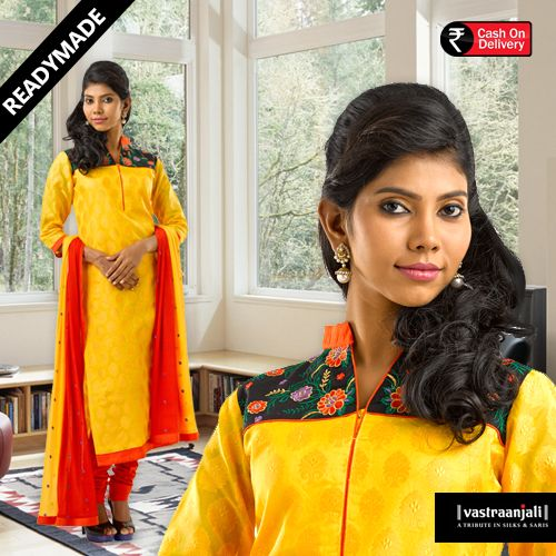 Yellow Banarasi kurta with mandarin collar, contrast embroidered panel at the chest and back. The mandarin collar is in orange and orange piping around the neckline.  For more details and online shopping visit www.vastraanjali.com