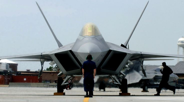 """F-22A Raptor Demonstration Team aircraft maintainers prepare to launch out Maj. Paul """"Max"""" Moga, the first F-22A Raptor demonstration team pilot, July 13, 2007. F-22 depot maintenance, which is currently split between the Ogden Air Logistics Complex at Hill Air Force Base, Utah, and a Lockheed Martin facility in Palmdale, Calif., will begin relocation exclusively to the Ogden ALC this month. (U.S. Air Force file photo/Senior Airman Christopher L. Ingersoll)"""