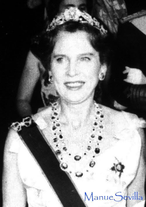 Queen Maria Jose of Italiy wearing Queen Margherita's Mellerio wreath tiara and her two diamond and sapphire necklaces. She's also wearing a bow brooch. The tiara was later sold, and the necklaces were inherited by her children: one by princess Maria Gabriella and the other by Prince Vittorio Emanuele and is now worn by his wife.