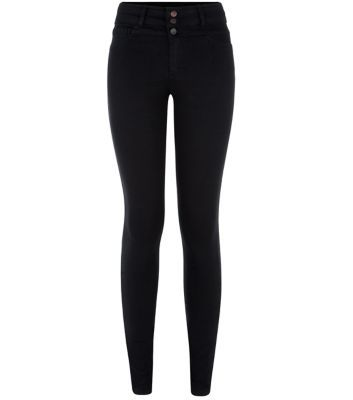 """These black supersoft high waisted skinny jeans are an essential wardrobe piece - try this season with a white halter neck top and block heel sandals.- High waisted design- Button and zip fly fastening- Supersoft finish- Skinny fit- Ankle length- Model is 5'8""""/176cm and wears UK 10/EU 38/US 6"""