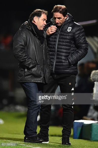 Angers' French head coach Stephane Moulin (L) speaks with... #lebourg: Angers' French head coach Stephane Moulin (L) speaks with… #lebourg