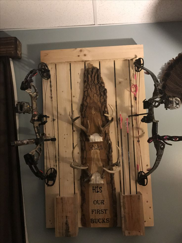 Bow rack from pallet wood. It holds your bow along with the arrows. We added our antlers to give it a personal touch. This is before stain.