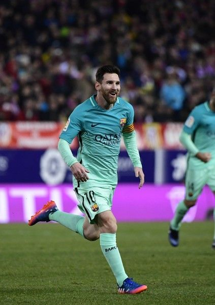 Barcelona's Argentinian forward Lionel Messi celebrates a goal during the Spanish Copa del Rey (King's Cup) semi final first leg football match Club Atletico de Madrid vs FC Barcelona at the Vicente Calderon stadium in Madrid on February 1, 2017. / AFP / PIERRE-PHILIPPE MARCOU