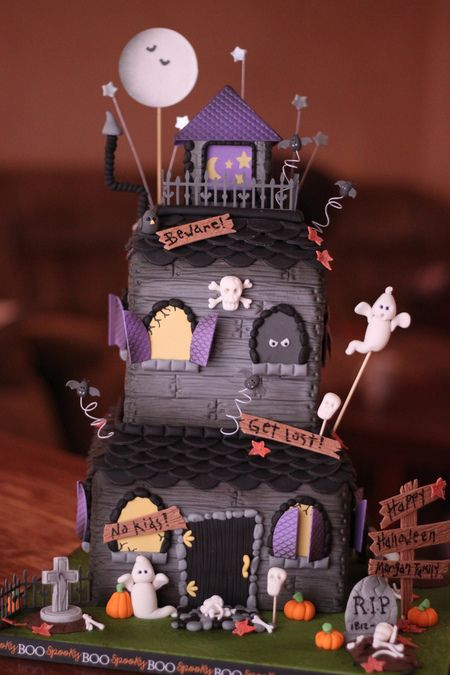 Tiny bones and fallen leaves. Itty bitty bats with fangs! Haphazardly hanging shutters! And so well-done too. I've never seen skeletons and gravestones looks so gosh darn adorable.