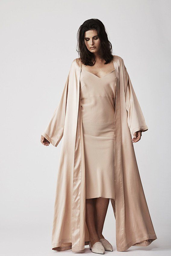 This 100% silk-satin robe is impeccably cut to create a soignée silhouette. It's floor-skimming length and relaxed fit slinks over the body. The perfect cover-up, layer it over our equally luxurious silk separates for a look that whispers unadulterated luxury.   Shown here with: silk crepe slip dress.  Expected to ship March 8, 2017 - March 15, 2017.  Details - Mid-weight, non-stretchy fabric  - Slips on  - Side seam pockets  - Unlined  - Soft hand feel, sleek & glossy  - 100% silk satin